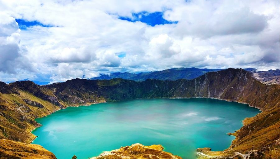 Scenic View Of Quilotoa Against Cloudy Sky