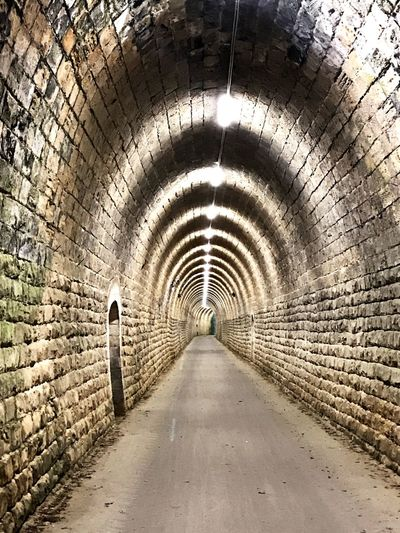 The Way Forward Direction Arch Architecture Diminishing Perspective Tunnel Built Structure Wall - Building Feature vanishing point No People Sunlight Outdoors Lifestyles Footpath Light At The End Of The Tunnel Transportation Wall Arched Day Nature