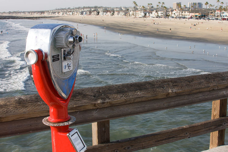 Close-up of coin-operated binoculars on beach