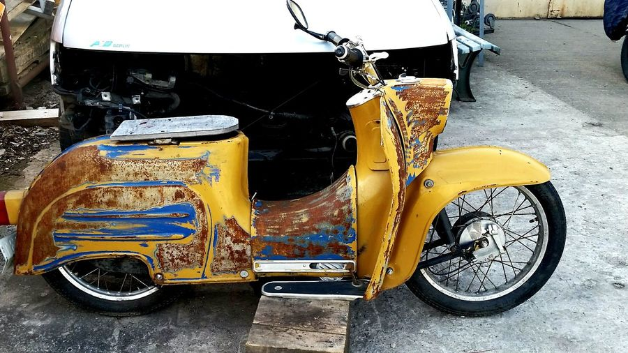 Schwalbe Motorrad Moped Transportation Mode Of Transport Street Land Vehicle Car Yellow Road Stationary Outdoors Day No People City Motorcycle