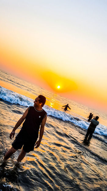 Having fun with such a beautiful sunset !! Sunset Only Men One Man Only Sea Adult Adults Only Beach Sun One Person People Outdoors Silhouette Water Full Length Mature Adult Nature Men Sand Sky Wave S8Photography My Smartphone Life Beauty In Nature The Street Photographer - 2017 EyeEm Awards Scenics Paint The Town Yellow The Week On EyeEm EyeEmNewHere Been There. Done That. Lost In The Landscape
