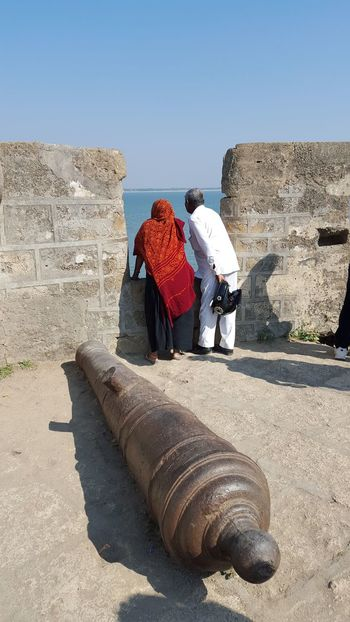 The fallen hero Fort Cannon Ruins Old Couple Ethnic Sea India Diu  Diufort Woman Man