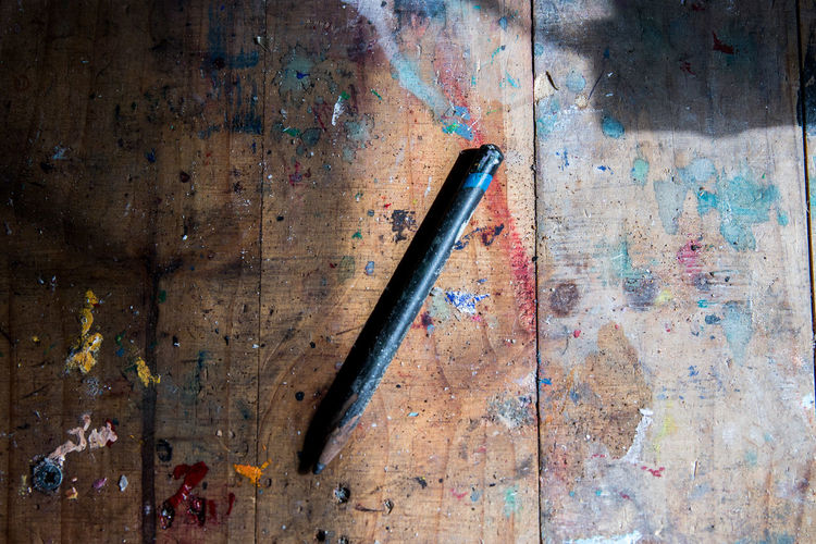 High angle view of pencil on wooden table