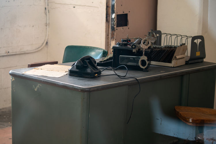 Old vintage car on table against wall
