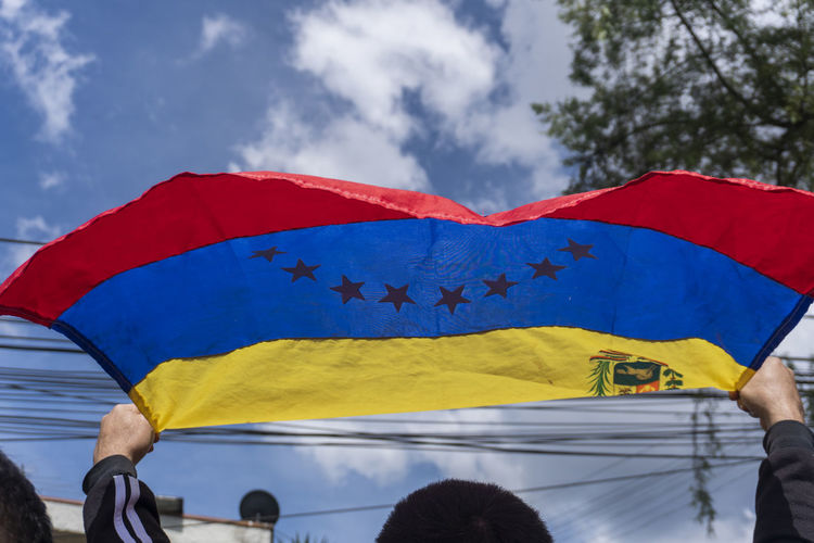 Sky Cloud - Sky Flag Real People Red Nature Yellow Day Blue Low Angle View Patriotism People Outdoors Star Shape Men Group Of People Protection Umbrella Adult Lifestyles Venezuela VenezuelaSomosTodos