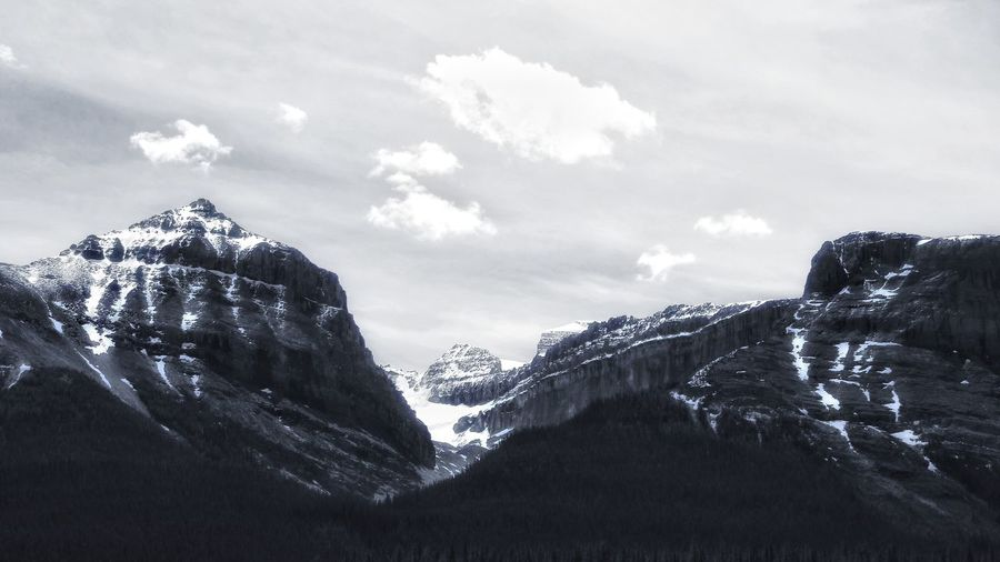 Scenics Tranquil Scene Mountain Beauty In Nature Tranquility Sky Snow Nature Season  Non-urban Scene Majestic Low Angle View Winter Idyllic Landscape Remote Rocky Mountains Mountain Range Physical Geography Cold Temperature