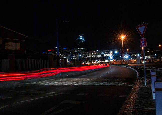 Architecture Building Exterior Built Structure City City Life City Street Illuminated Light Trail Lighting Equipment Long Exposure Motion Nature Night No People Outdoors Road Sign Speed Street Street Light Transportation