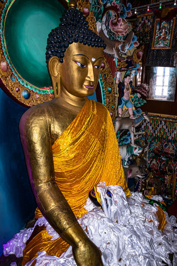 Statue of buddha against building