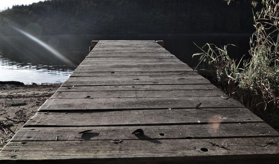 Boardwalk amidst pier over lake
