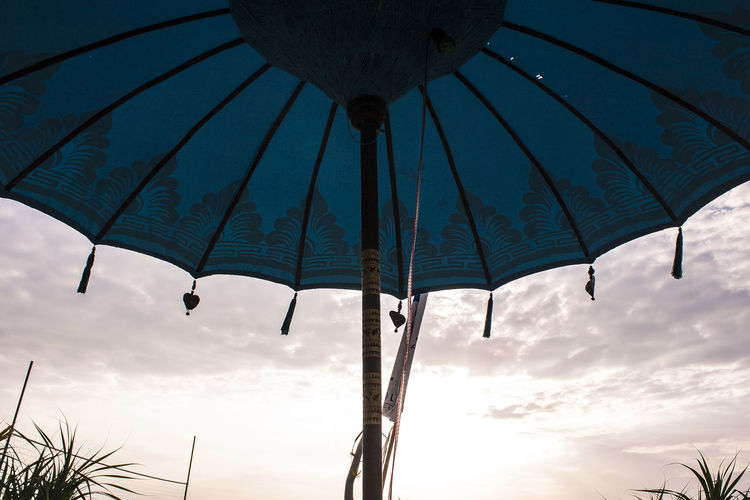 Delicate traditional beach umbrella Bali Hindu Holiday INDONESIA Meditation Travel Beach Beach Umbrella Beach Vacation Beauty In Nature Cloud - Sky Day Low Angle View Nature No People Outdoors Palm Tree Shade Sky Sunset Sunshade Traditional Tranquility Umbrella
