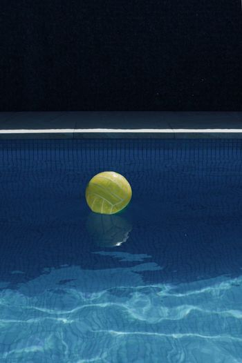 High angle view of beach ball floating on swimming pool