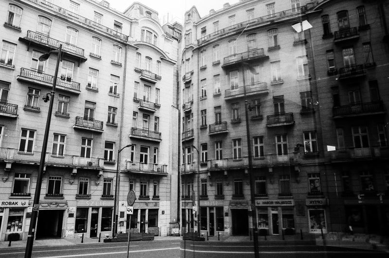 Analog; Nikon FM2 / Ilford PAN 100 The Art Of Street Photography The Week on EyeEm Capture The Moment Everyday Life Nikonphotography Analogue Photography Film Photography Grain Ilford Light And Shadow Warsaw Building Exterior Architecture Built Structure Window Building Residential District City No People Day Outdoors Apartment Street City Life Full Frame Low Angle View Air Conditioner Repetition Nature Backgrounds Housing Development