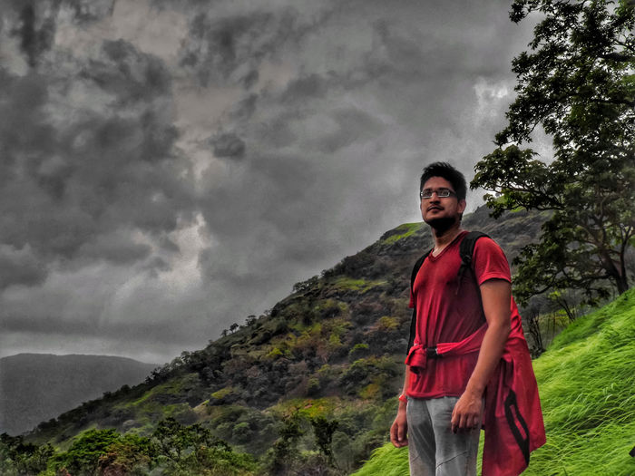 When the dark clouds of doubt, anger or worry begin to move upon you, steady yourself in the knowledge that in time, the storm will pass - McGill Adults Only Adult Smiling Nature Red Outdoors One Person People Happiness Cloud - Sky Portrait Only Men Cliff One Man Only Looking At Camera Young Adult Standing Day Real People Sky India Maharashtra Rajmachi Rajmachifort The Week On EyeEm