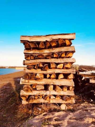 Landscape Heating Wood - Material Wood Timber EyeEm Selects Sky Land Nature Water Beach Sea Blue Tranquil Scene Clear Sky Architecture Scenics - Nature Tranquility Sunlight No People Stack Day Non-urban Scene Built Structure Beauty In Nature Outdoors