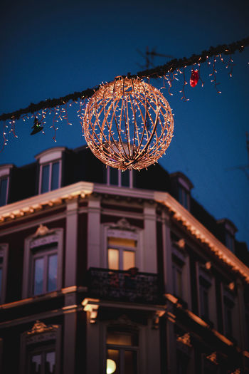 christmas decoration in Lille Building Exterior Built Structure Architecture Decoration Illuminated Low Angle View No People Sky Building Blue Celebration Night Dusk Lighting Equipment Nature Focus On Foreground Christmas Decoration Hanging Sphere City Outdoors Christmas Ornament