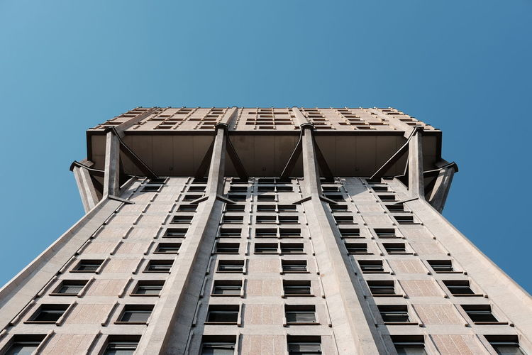 Architecture Blue Building Building Exterior Built Structure City Classic Chrome Day Fujifilm Fujifilm_xseries High Section Low Angle View Milano Modern No People Outdoors Repetition Sky Symmetry Torre Velasca Urban Urban Exploration Urban Geometry Urban Landscape