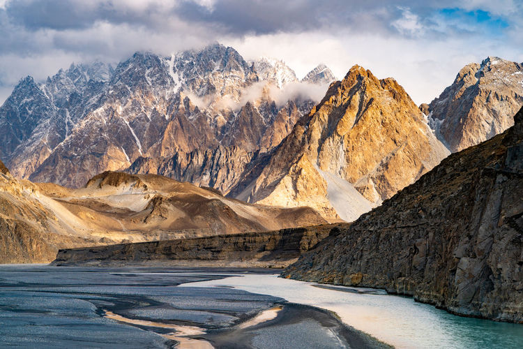 Mountain Peaks II Passu - Pakistan Mountain Peaks With Snow Peaks Passu Pakistan Mountain Mountain Range Beauty In Nature Scenics - Nature Sky Cloud - Sky Nature No People Water Landscape Cold Temperature Environment Rock Non-urban Scene Tranquil Scene Lake Day Snow Formation Outdoors Mountain Peak Snowcapped Mountain