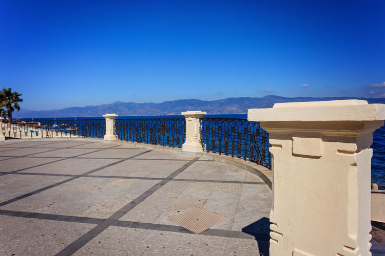 Calabria (Italy) Promenade Reggio Di Calabria ReggioCalabria Via Marina Architecture Banister Beach Beauty In Nature Blue Built Structure Cast Iron Clear Sky Day Nature No People Outdoors Reggio Calabria Sea Shadow Sky Sunlight Water