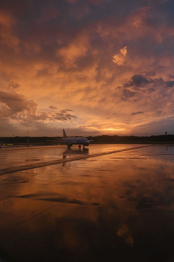 Plane waiting to departure Air Vehicle Airplane Airport Airport Runway Airport Terminal Beauty In Nature Cloud - Sky Journey Mode Of Transport Nature No People Outdoors Plane Reflection Runway Scenics Silhouette Sky Sunrise Sunset Transportation Travel Vacation Water