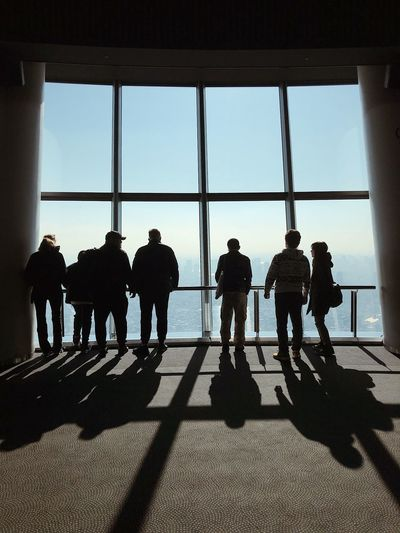 People look out towards a skyline of Tokyo in midday, from the obsservation deck of Tokyo Skytree, the highest tower in the world. #tokyo #travel #japan #shadow #light Group Of People Shadow Real People Men Architecture Sky People Day