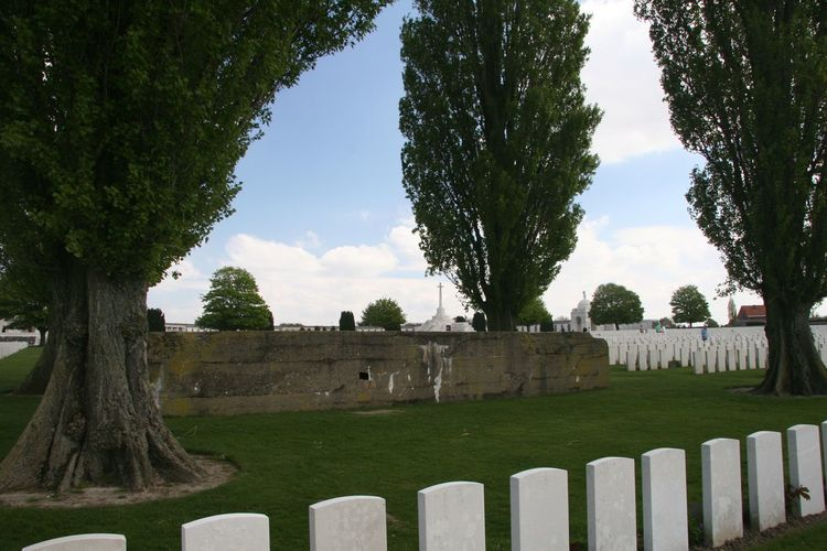 Tyne Cot, the largest Commonwealth military cemetery in the world, contains two large concrete bunkers which once formed a part of the German defensive line on the ridge at Passchendaele. The land on which this cemetery stands is the free gift of the Belgian people for the perpetual resting place of those of the allied armies who fell in the war of 1914-1918 and are honoured here. The Tyne Cot Commonwealth War Graves Cemetery and Memorial to the Missing is a burial ground for the dead of the First World War in the Ypres Salient on the Western Front. http://pics.travelnotes.org/ 1914-1918 Belgium Bunker Cemetery Commonwealth Military Cemetery Michel Guntern Passchendaele Travel Photography Trees Tyne Cot Cemetery Concrete Defensive Line German Bunker Graves Gravestone Graveyard Largest Memorial No People Outdoors The Past Travelpics Trees And Sky World War One