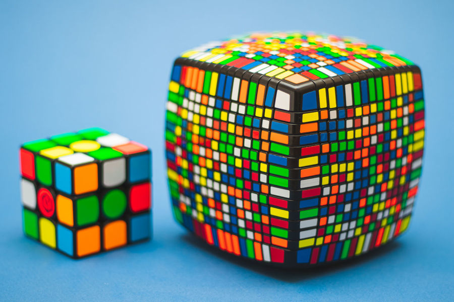 Smart Algorithm Block Blue Blue Background Business Choice Close-up Colored Background Complexity Cube Shape Indoors  Intelligence Multi Colored Rubik's Cube Stack Studio Shot Toy Toy Block Variation