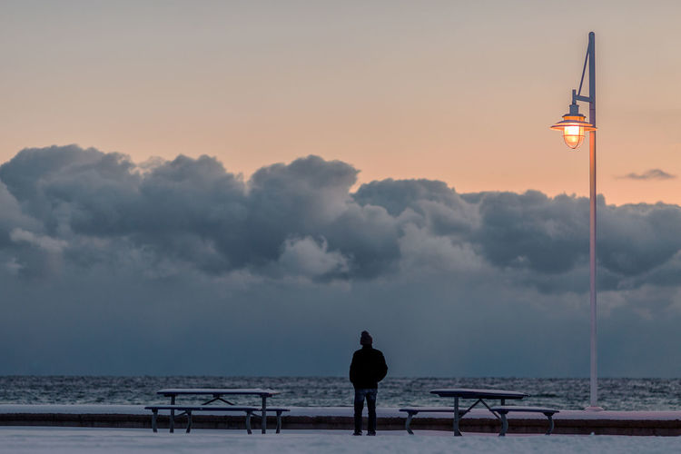 Solitude Winter Cold Temperature Canada Lakeshore Lake Snow Cold person Man Lonley Solitary Peaceful Quiet Tranquility Tranquil Scene Water Silhouette People One Person Sky Sea Fisherman Beach Sunset Full Length Adult One Man Only Outdoors Day Colour Your Horizn