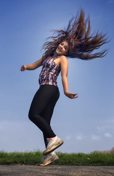 Hair Freedom Jumping Jumping Girl Long Hair One Person Outdoors Playing Girl Smiling Tousled Hair Young Girl Young Girl With Smiling Face