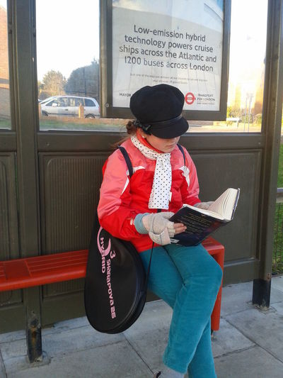 When waiting for a late bus, reading a book is the cure Boys Cap Casual Clothing Childhood Communication Day Eyeem Reading Fun Full Length Guitar One Person Outdoors Reading Real People Sitting Tennis Text Transportation Vehicle Seat