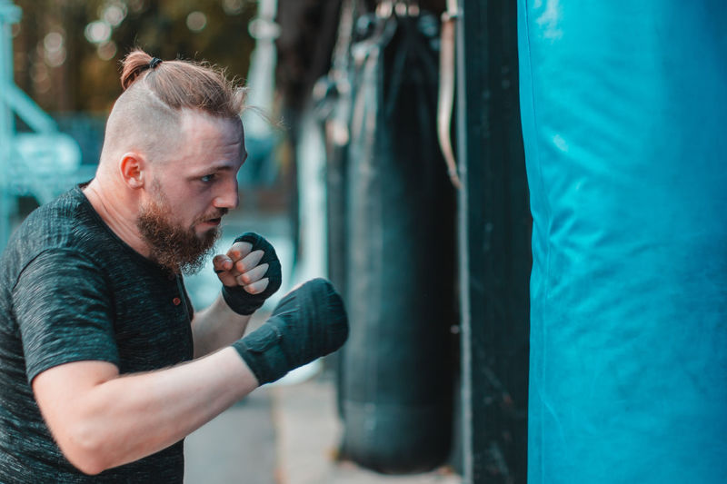 Young man boxing at gym