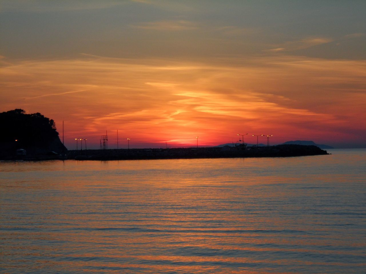 sunset, sky, waterfront, sea, water, nature, silhouette, no people, beauty in nature, tranquility, scenics, outdoors, tranquil scene, cloud - sky, built structure, architecture, day
