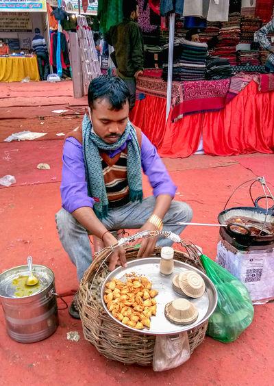 Full length of man wearing mask at market stall