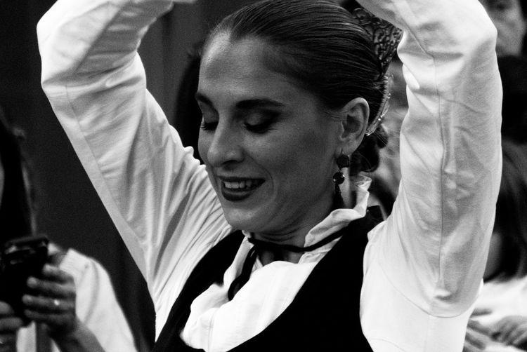 Smiling woman dancing during festival
