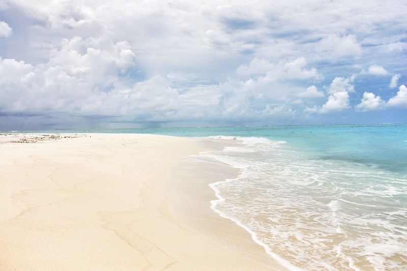 Sea Beach Sand Horizon Over Water Beauty In Nature Water Scenics Sky Cloud - Sky Nature Shore Tranquil Scene Tranquility Day Outdoors No People Wave Vacations Vacations Travel Destinations Fiji Fiji Islands Fidschi Fiji Beauty Tranquility