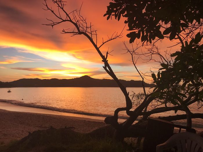 Sunset Beauty In Nature Scenics Nature Silhouette Sea Tranquility Orange Color Tranquil Scene No People Sky Water Outdoors Beach Tree Sunlight Mountain Horizon Over Water Day Cloud - Sky Beauty In Nature Nature Dramatic Sky Costa Rica Holiday