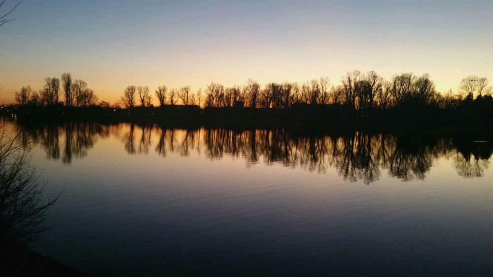 Water Reflection Sunset Nature Silhouette Motion Outdoors No People Sky Wien City Donauinsel Donau Austria Beauty In Nature HuaweiP9 Vienna Lake