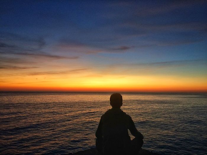 Sea Sunset Horizon Over Water Silhouette Water Scenics Beauty In Nature Nature Sky Real People Tranquil Scene Tranquility Leisure Activity Rear View Standing Men Outdoors Lifestyles One Man Only