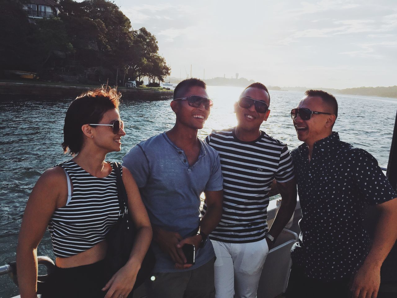 young adult, sunglasses, young men, young women, casual clothing, real people, leisure activity, water, togetherness, outdoors, smiling, lifestyles, transportation, happiness, standing, nautical vessel, bonding, day, sailing, sky, nature, friendship