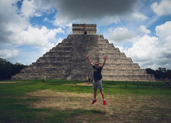 Chichen Itza Mexico Sky Cloud - Sky Built Structure Architecture Real People Grass This Is Latin America One Person Day Lifestyles Nature History The Past Travel Destinations Full Length