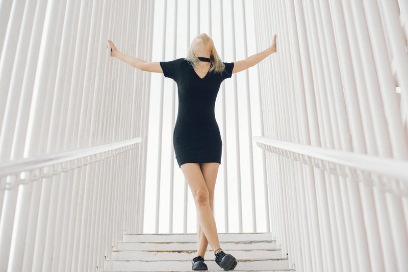 Full Length Of Woman Standing On Steps Amidst Railing