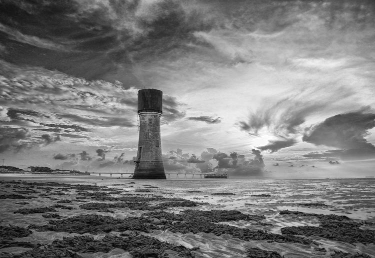 Architecture Beach Beauty In Nature Building Building Exterior Built Structure Cloud - Sky Day Guidance History Land Lighthouse Nature No People Outdoors Scenics - Nature Sea Sky Tower Water