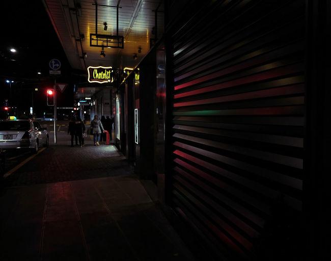 Illuminated text at night