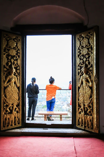 view point from Laungprabang,Loas Adult Architecture Art And Craft Belief Built Structure Creativity Day Door Full Length People Rear View Religion Spirituality Standing Window