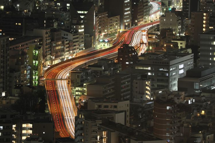 Architecture City Built Structure Building Exterior Illuminated Street Night Transportation Cityscape Motion No People Building Road High Angle View Traffic City Life Long Exposure Outdoors Speed Office Building Exterior Multiple Lane Highway Skyscraper Highway Tokyo Exposure