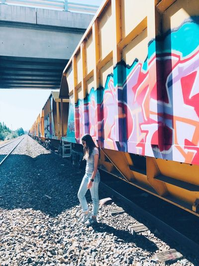 Outdoors One Person Casual Clothing Full Length Multi Colored Train Tracks Day Real People Lifestyles Only Women Adult Side Photo Landscape Sky StillLifePhotography