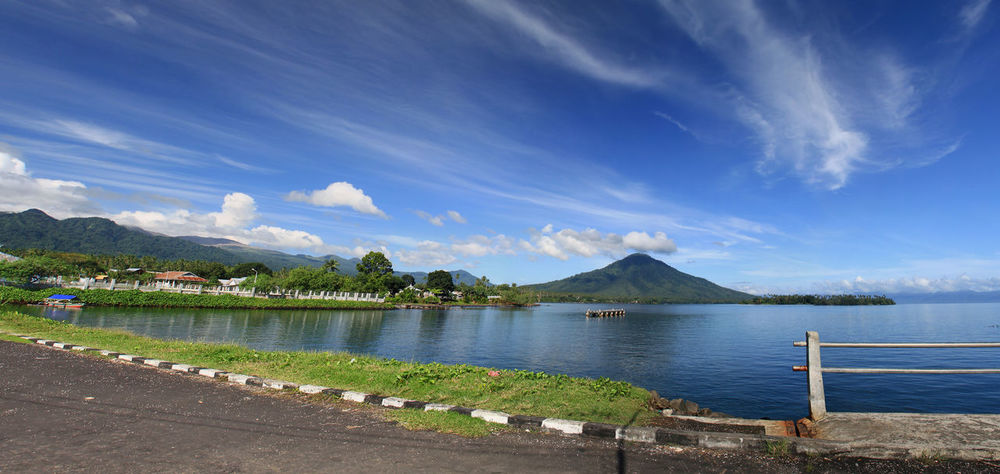 Panorama of Tobelo No People Sea Seascape Landscape INDONESIA Halmahera Tobelo Maluku Utara Tropical Tropical Paradise Tranquility Beach Water Mountain Blue Lake Sky Landscape Cloud - Sky Mountain Range Calm Boat Deck Bay Of Water Island Lagoon Coastline