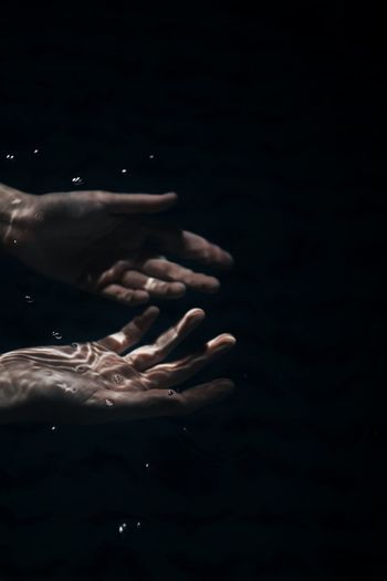Under the dark water. Canon Chile Pool Summer Dark Water Human Hand Black Background Space Splashing Droplet Water Spirituality Close-up Finger Palm Hand Human Finger Body Part My Best Photo