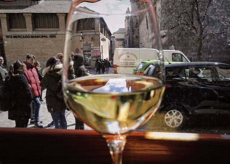 Drink Food And Drink Refreshment Glass Alcohol Building Exterior Architecture Built Structure Glass - Material Real People City Toledo SPAIN White Wine Window View Restaurant Old Town Tourist Attraction  Cars Square Group Of People Reflection Transparent CastillaLaMancha Springtime