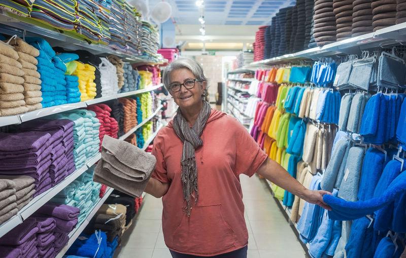 Portrait of senior woman standing in supermarket