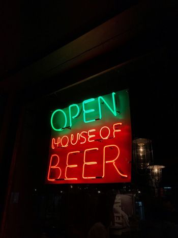 OPEN HOUSE OF BEER Bar Red Color Green Color Green Red Sign Beer Open Text Illuminated Western Script Communication Night Neon Sign Red Capital Letter No People Lighting Equipment Information Low Angle View Architecture Commercial Sign Building Exterior Built Structure Information Sign Close-up City